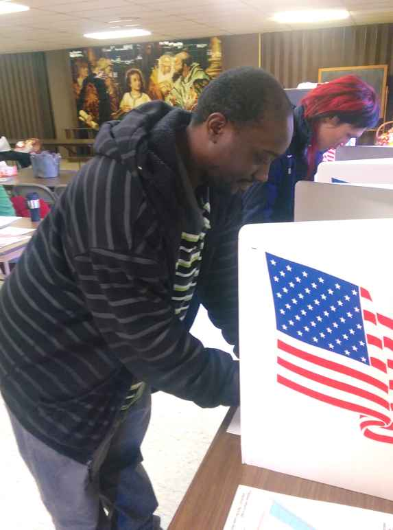 A man voting in 2014